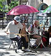 Two Chinese street performers China Town, New York City, NY, USA