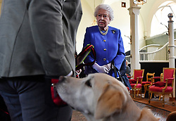 Queen Elizabeth II speaks to members of Medical Detection Dogs during the 10th anniversary celebration of the charity at the Royal Mews in London.