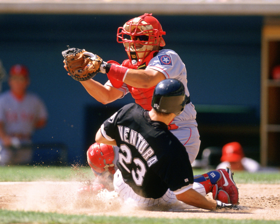 CHICAGO - 1998:  Ivan Rodriguez of the Texas Rangers catches during an MLB game versus the Chicago White Sox at Comiskey Park in Chicago, Illinois during the 1998 season. (Photo by Ron Vesely).  Subject:   Ivan Rodriguez