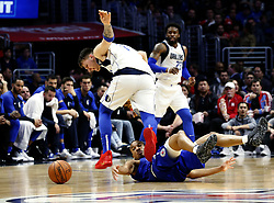 December 20, 2018 - Los Angeles, California, U.S - Los Angeles ClippersÃ• Avery Bradley (11) falls to the court for a ball against Dallas Mavericks' Luka Doncic (77) in an NBA basketball game between Los Angeles Clippers and Dallas Mavericks om Thursday, Dec. 20, 2018, in Los Angeles. (Credit Image: © Ringo Chiu/ZUMA Wire)