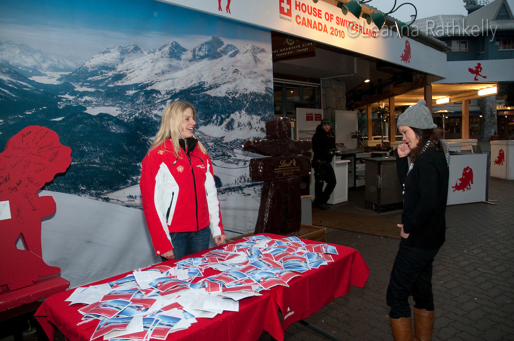 The lucky winner of a trip to Switzerland is drawn by Swiss athlete at the House of Switzerland in Whistler during the 2010 Olympic Winter Games.