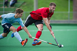 Southgate's James Kyriakides is tackled by an Old Georgians player. Southgate v Old Georgians - Men's Hockey League, East Conference, Trent Park, London, UK on 23September 2017. Photo: Simon Parker