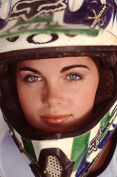 beautiful girl in a motocross helmet