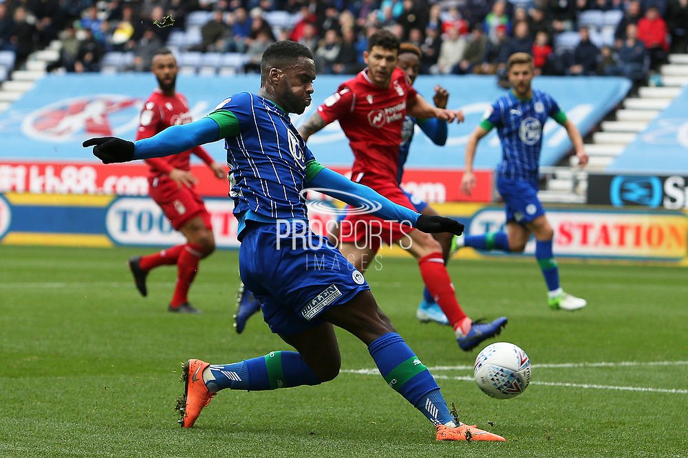 Wigan Athletic forward Gavin Massey (11) cuts the ball back into the box for Wigan Athletic forward Jamal Lowe (9) to score during the EFL Sky Bet Championship match between Wigan Athletic and Nottingham Forest at the DW Stadium, Wigan, England on 20 October 2019.