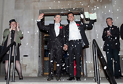 © Licensed to London News Pictures . 28/03/2014. London, UK.  Newlyweds Peter McGraith, left, and David Cabreza become one of the first in the UK to marry under the new law tonight (29/03/14) at Islington Town Hall, east London. They were supported by GAY rights campaigner Peter Tatchell (far right). Photo credit: Isabel Infantes /LNP