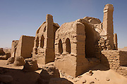 The remains of mud brick Christian tombs at Al-Bagawat Coptic necropolis, al-Kharga, Western Desert, Egypt. Al-Bagawat, (also, El-Bagawat) one of the oldest and best preserved ancient Christian cemeteries in the world, which functioned at the Kharga Oasis in southern-central Egypt from the 3rd to the 7th century AD. Coptic frescoes of the 3rd to the 7th century are found on the walls and there are 263 funerary chapels of which the Chapel of Exodus (5th or 6th century) and Chapel of Peace (of mid 4th century) have frescoes.