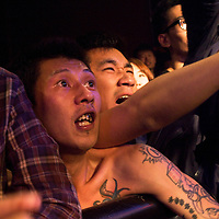 BEIJING, OCTOBER 2013 : Fans cheer legendary punk band Anarchy Boys at Beijing's Yugong Yishan Club.