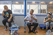 GUANGZHOU, CHINA - OCTOBER 02: (CHINA OUT)<br /> <br /> Chinese Obama Imitator<br /> <br /> Xiao Jiguo (C) who is famous for imitating American President Obama wears a tie before acting in a comedy at a warehouse on October 2, 2015 in Guangzhou, China. Xiao Jiguo, born in Sichuan province, was well-known as an imitator of American President Barack Hussein Obama after acting in a Chinese entertainment program. He became a star among the commercial events and acted in a comedy during the China\'s National Day Holiday in Guangzhou.<br /> ©Exclusivepix Media