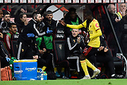 Goal - Abdoulaye Doucoure (16) of Watford celebrates at the dugout after he scores a goal to give a 0-1 lead during the Premier League match between Bournemouth and Watford at the Vitality Stadium, Bournemouth, England on 12 January 2020.