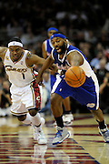 Jan 31, 2010; Cleveland, OH, USA; Cleveland Cavaliers guard Daniel Gibson (1) and Los Angeles Clippers guard Baron Davis (1) fight for a loose ball during the second quarter at Quicken Loans Arena. Mandatory Credit: Jason Miller-US PRESSWIRE