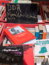 Secondhand books about the former communist DDR  for sale at bohemian cafe and bookshop Tasso on Karl Marx Allee in former East Berlin in Germany