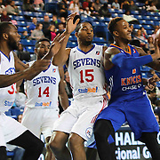 Westchester Knicks Forward Chris Johnson (4) passes the ball while driving towards the basket as Delaware 87ers Forward Rahlir Hollis-Jefferson (15) defends in the first half of a NBA D-league regular season basketball game between the Delaware 87ers and the Westchester Knicks (New York Knicks) Sunday, Dec. 28, 2014 at The Bob Carpenter Sports Convocation Center in Newark, DEL