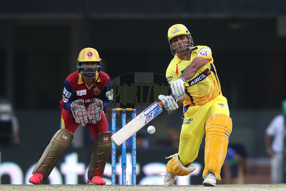Chennai Super Kings Captain MS Dhoni attacks a delivery during match 37 of the Pepsi IPL 2015 (Indian Premier League) between The Chennai Superkings and The Royal Challengers Bangalore held at the M. A. Chidambaram Stadium, Chennai Stadium in Chennai, India on the 4th May April 2015.<br /> <br /> Photo by:  Shaun Roy / SPORTZPICS / IPL