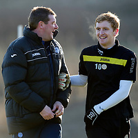 St Johnstone Training...13.01.12<br /> Liam Craig pictured with assistant manager Tommy Wright during training this morning ahead of tomorrow's game against Rangers.<br /> Picture by Graeme Hart.<br /> Copyright Perthshire Picture Agency<br /> Tel: 01738 623350  Mobile: 07990 594431