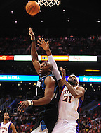 Apr. 11, 2011; Phoenix, AZ, USA; Minnesota Timberwolves forward Anthony Tolliver (44) puts up a shot against the Phoenix Suns forward Hakim Warrick (21) at the US Airways Center. Mandatory Credit: Jennifer Stewart-US PRESSWIRE