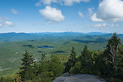 Adirondacks, NY.  An early morning start got me up to the summit of Pharoah Mountain, where I watched the clouds roll eastward from the High Peaks, arranged in a jagged background on the horizon.  Crane Pond, where I began, reflected the blueness of the sky, and miles of wilderness stretched away.   What drives me to these places?  So many mountains and streams, so many destinations.  My eyes follow contours and lines that lead to even more, distant destinations, and then I record it all with this instrument.  For what?  So you can share my experience, feel what I feel, see what I see?  You can't, because what drives me here are dark thoughts, what I feel is a sadness that borders on despair in my soul.  I hope to see something that renews me, that chases the cloud away from me like it does those above.  And maybe it will, for awhile.  So you can see what I see.