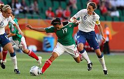 27.06.2011, Arena im Allerpark Wolfsburg, Wolfsburg,  GER, FIFA Women Worldcup 2011, Gruppe B, Mexico (MEX) vs. England (ENG).im Bild Casey Stoney (England) gegen Monica Ocampo (Mexico)  during the FIFA Women Worldcup 2011, Pool B, Mexico vs England on 2011/06/26, Arena im Allerpark , Wolfsburg, Germany.  .EXPA Pictures © 2011, PhotoCredit: EXPA/ nph/  Hessland       ****** out of GER / SWE / CRO  / BEL ******