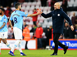 Manchester City Boss Pep Guardiola celebrates with  Ilkay Gundogan at full time during the Premier League match at The Vitality Stadium, Bournemouth.