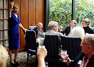 World War II veteran Walter Stone Jr's daughter, Debra Stone, toasts the guest of honor at his 100th birthday celebration at the Dan'l Webster Inn.