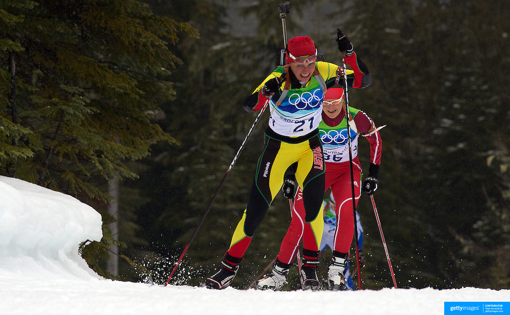 Winter Olympics, Vancouver, 2010. Diana Rasimoviciute, Lithuania, (centre)  in action during the Women's 7.5 KM Sprint Biathlon at The Whistler Olympic Park, Whistler, during the Vancouver  Winter Olympics. 13th February 2010. Photo Tim Clayton