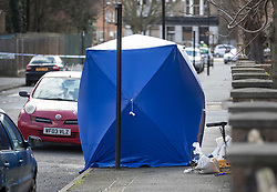 © Licensed to London News Pictures. 26/03/2018. London, UK. An evidence tent covers an area where a man was shot in Hackney. A murder investigation has been launched after a 26-year-old man was discovered in the street suffering from gunshot wounds on Sunday night. Despite the best efforts of paramedics, he was pronounced dead at the scene. Photo credit: Peter Macdiarmid/LNP
