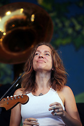 05 May 2012. New Orleans, Louisiana,  USA. .New Orleans Jazz and Heritage Festival. .Ani DiFranco performs with the 'Preservation Hall and Friends' ensemble. .Photo; Charlie Varley.
