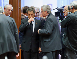 Nicolas Sarkozy, France's president, center left, speaks with Jean-Claude Juncker, Luxembourg's prime minister, center right, during an emergency EU Summit to solve Europe's debt crisis at the European Council headquarters in Brussels, Belgium, on Wednesday, Oct. 26, 2011. (Photo © Jock Fistick)