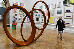&copy; Licensed to London News Pictures. 08/06/2017. London, UK. A visitor passes by a scuplture called &quot;Natural Pearl&quot; by Nigel Hall RA (GBP189,600).  Preview of the Summer Exhibition 2017 at the Royal Academy of Arts in Piccadilly.  Co-ordinated by Royal Academician Eileen Cooper, the 249th Summer Exhibition is the world's largest open submission exhibition with around 1,100 works on display by high profile and up and coming artists.<br />  Photo credit : Stephen Chung/LNP