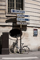 abandoned bike and road sign in Paris France in May 2008