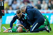 Bruno Saltor (#2) of Brighton & Hove Albion receives treatment following a foul during the Premier League match between Newcastle United and Brighton and Hove Albion at St. James's Park, Newcastle, England on 20 October 2018.