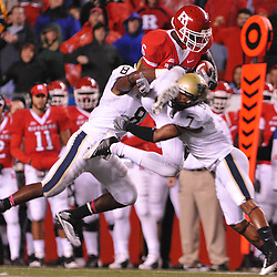 Oct 16, 2009; Piscataway, NJ, USA; Rutgers wide receiver Mohamed Sanu (6) tries to hurdle Pittsburgh cornerback Jovani Chappel (7) and linebacker Adam Gunn (8) during first half NCAA football action in Pittsburgh's 24-17 victory over Rutgers at Rutgers Stadium.