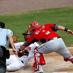 March 24, 2012; Sarasota, FL, USA; Washington Nationals catcher Wilson Ramos (3) tags out Baltimore Orioles designated hitter Wilson Betemit (24) at home during the bottom of the fourth inning of a spring training game at Ed Smith Stadium.  Mandatory Credit: Derick E. Hingle-US PRESSWIRE
