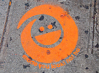 New York, New York City.  Amusing sidewalk painting.