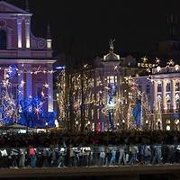 LJUBLJANA, SLOVENIA - DECEMBER 02:  Locals and tourists cross the pedestrian bridge in front of the decorated Franciscan church in the city centre on December 2, 2017 in Ljubljana, Slovenia. The traditional Christmas market and lights will stay until 1st week of January 2018.  (Photo by Marco Secchi/Getty Images)