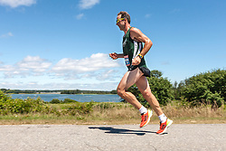 Great Cranberry Island Ultra 50K road race: overall winner Brian McNeiece on way to victory