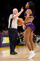 27 March 2007: NBA official Joe Crawford referees the game between the Memphis Grizzlies and the Los Angeles Lakers as the Laker Girls perform during the Grizzlies 88-86 victory over the Lakers at the STAPLES Center in Los Angeles, CA.