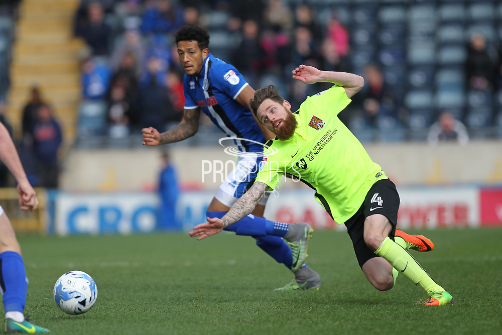 Paul Anderson and Nathaniel mendez-Laing compete for the ball during the EFL Sky Bet League 1 match between Rochdale and Northampton Town at Spotland, Rochdale, England on 1 April 2017. Photo by Daniel Youngs.