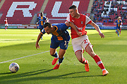Shrewsbury Town player Donald Love (17) and Rotherham United player Jake Hastie (23) during the EFL Sky Bet League 1 match between Rotherham United and Shrewsbury Town at the AESSEAL New York Stadium, Rotherham, England on 21 September 2019.