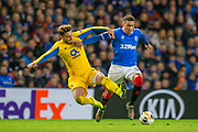 Alex Telles (#13) of FC Porto tackles James Tavernier (#2) of Rangers FC during the Group G Europa League match between Rangers FC and FC Porto at Ibrox Stadium, Glasgow, Scotland on 7 November 2019.