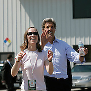 Newsweek reporter Suzannah Meadows is surprised by Sen. John Kerry (D-MA) as they play catch with staffers and press at the Long Beach Airport Thursday, August 12, 2004, in Long Beach, CA...Photo by Khue Bui