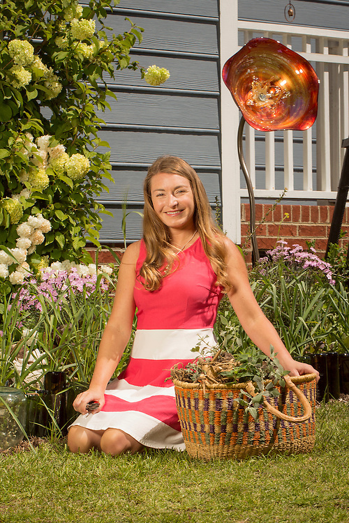 Brienne Gluvna is a leader in the foodscaping movement, emphasizing a balance of ornamentals and edibles for a visually appetizing result, pictured in her home garden in Fuquay-Varina, North Carolina, on Friday, April 8, 2016. <br /> Photo by D.L. Anderson for Ornamental Breeder Edibles: garlic, wheat, mustard <br /> Ornamentals:<br /> Dianthus, serissa, <br /> Viburnum plicatum 'popcorn'