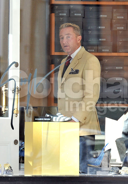 (UK RIGHTS ONLY) Lord of the dance: Michael Flatley and his wife Niamh out shopping for shoes at Gina in Knightsbridge, London, UK. 15/10/2012<br />