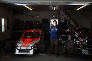 Mike Willis Jr. poses in his family's garage in Grantham, N.H., on March 21, 2014. Willis was a seven-time series champion and winner of 102 total races at Canaan Speedway, and has moved to his first touring division, the Valenti Modified Racing Series. (Valley News - Will Parson)