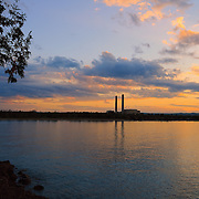 &quot;Smoke Stack Sunset&quot;<br /> <br /> A gentle sunset on calm waters of Lake Superior, looking back onto Marquette from Presque Isle Park.