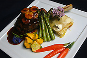 Park Place on Main: Veal chop covered in Buccaneer sauce, a banana and veal reduction, with sage and basil scalloped potatoes, baby carrots, baby sunburst squash and asparagus.