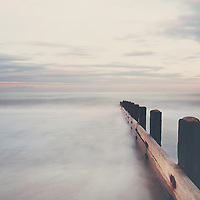 the tide slowly comes in on the Norfolk coastline,at dusk, beautiful pastels & soft tones