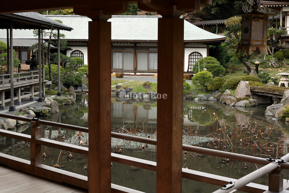 view towards residential section with pond at Komyoji Temple in Kamakura Japan