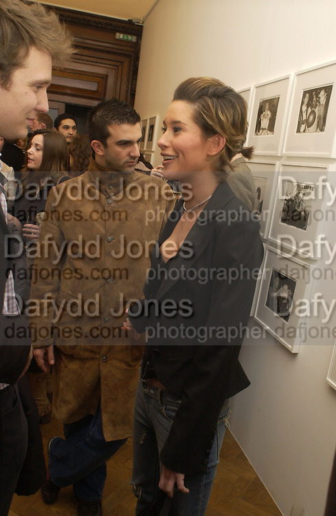 Jasmine Lennard and Mark Alexiou. Warhol's World. Photography and Television. Hauser and Wirth. Piccadilly, London. 26  January 2006.  ONE TIME USE ONLY - DO NOT ARCHIVE  © Copyright Photograph by Dafydd Jones 66 Stockwell Park Rd. London SW9 0DA Tel 020 7733 0108 www.dafjones.com