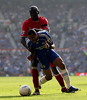 Photo: Paul Thomas.<br /> Blackburn Rovers v Chelsea. The FA Cup, Semi Final. 15/04/2007.<br /> <br /> Christopher Samba of Blackburn fouls Ashley Cole (Ground) of Chelsea