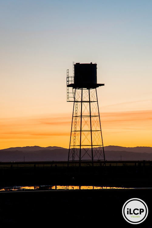 USA: California, CA Drought Expedition #4, San Joaquin River Basin, Rt 33 between Firebaugh and Mendota, water tower against sunset